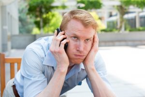 frustrated man on the phone