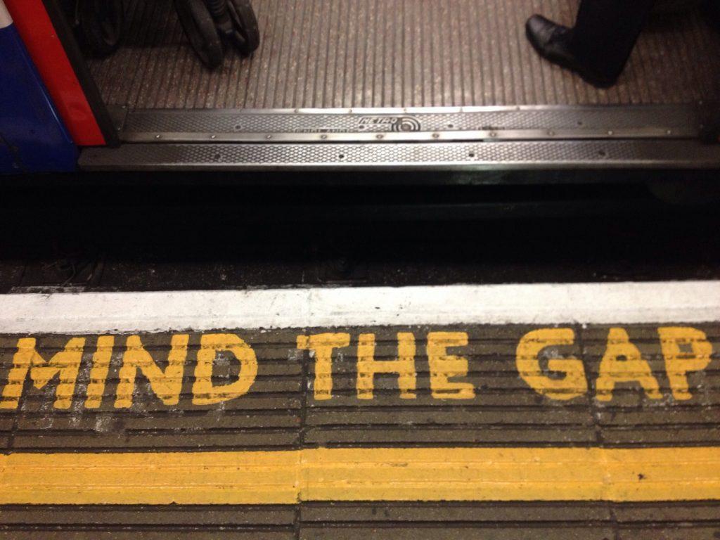 "A ""mind the gap"" warning on a subway platform"