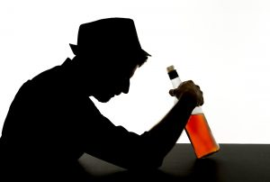 Alcoholic man with a bottle
