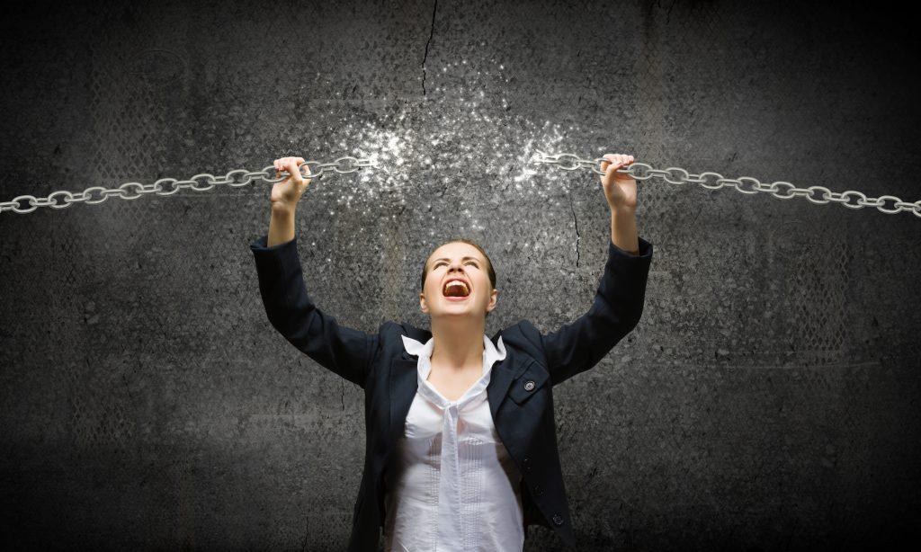 business woman braking a chain