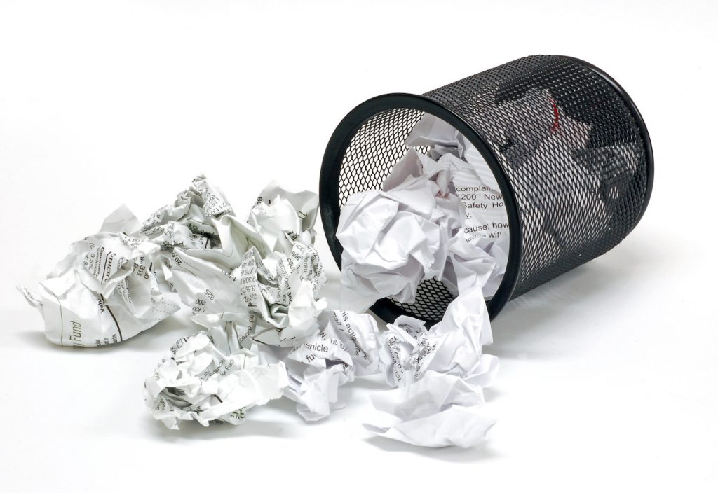 office wastebasket full of discarded paper