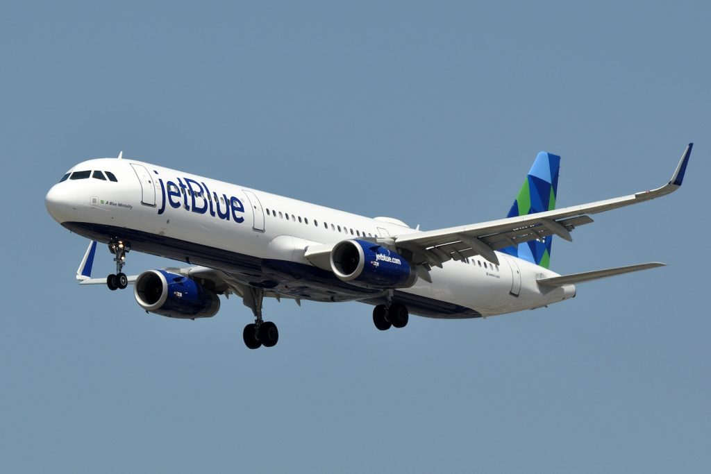 A Jet Blue plane in the sky